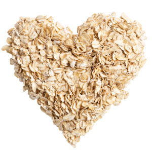 heap of oat flakes in a shape of heart shot from above